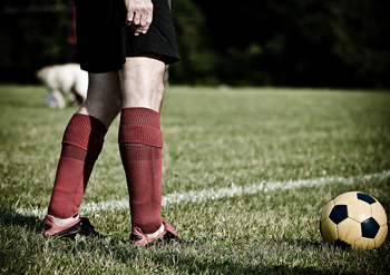 Soccer player's legs and ball