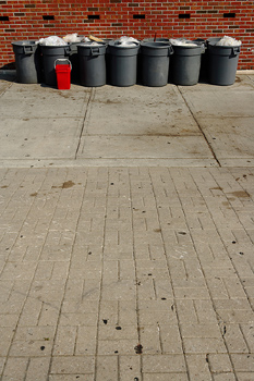 Trash cans in urban setting