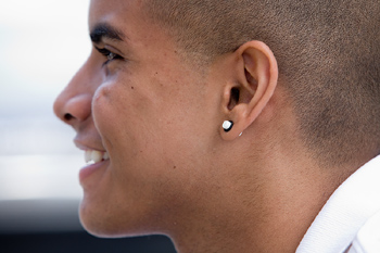 Profile of smiling man with earring