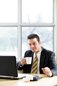 Smiling accountant with coffee cup