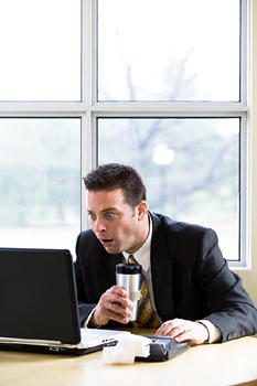 Shocked accountant at desk