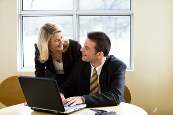 Business co-workers using laptop
