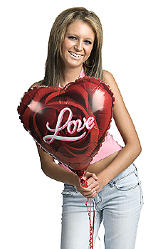 Teenage girl posing with love balloon