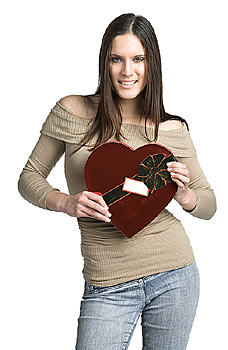 Young woman posing with valentines heart