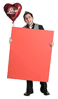 Man posing with pink board and love balloon