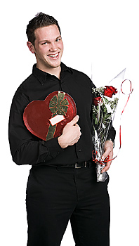 Man posing with valentines gifts