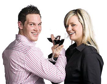 Couple celebrating with red wine