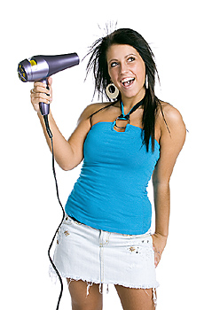 Young woman posing with hair dryer