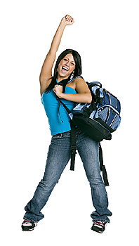 Woman with backpack raising hand in victory