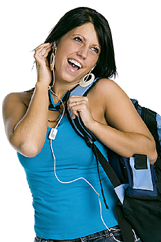 Young woman with backpack and headphones