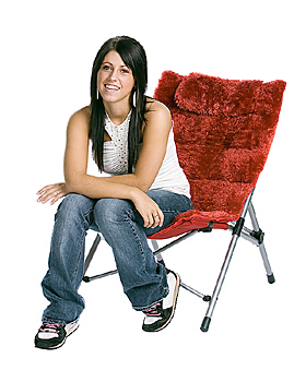 Young woman sitting in modern chair
