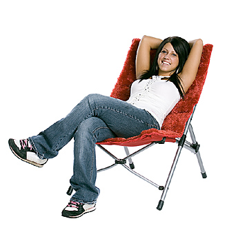 Young woman reclining in modern chair