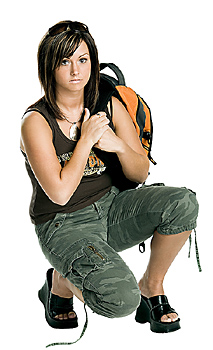 Young woman posing with backpack