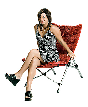 Woman in dress posing in modern chair
