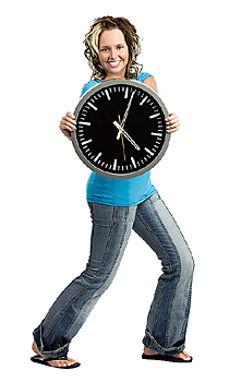 Young woman posing with clock