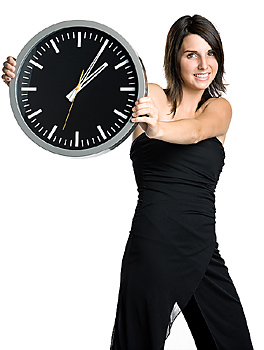 Woman in formal attire with clock