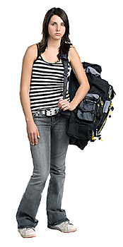 Unhappy young woman posing with backpack