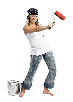 Woman with paint roller and cans