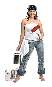 Young woman posing with paint cans and roller
