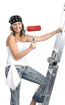 Young woman climbing ladder with paint roller