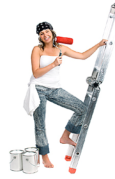 Young woman posing with ladder and paint roller