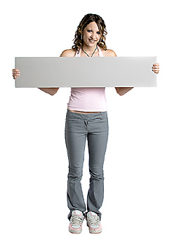 Young woman posing with blank board
