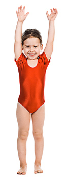 Girl wearing leotard with arms raised