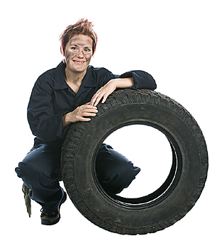 Mechanic posing with tire