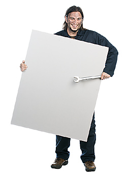 Mechanic posing with blank poster board