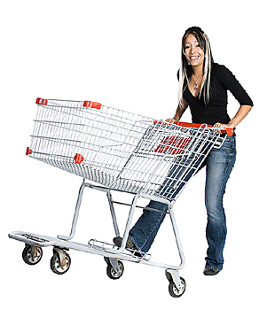 Woman popping wheelie with shopping cart