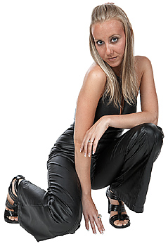 Woman posing in leather outfit