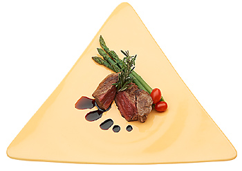 Beef served with asparagus