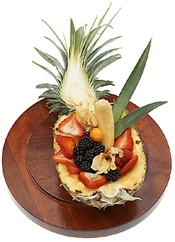 Fruit served in half of a pineapple