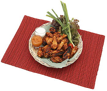 Chicken wings with sauce in basket