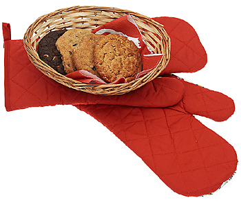 Cookies in basket with kitchen mitts