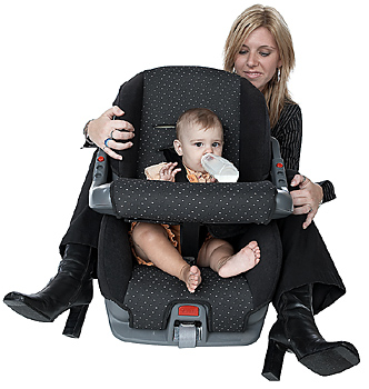 Mother with baby girl in car seat