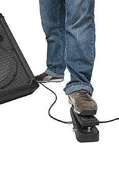 Person stepping on amplifier pedal