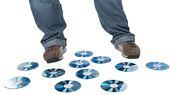 Person standing amid compact disks