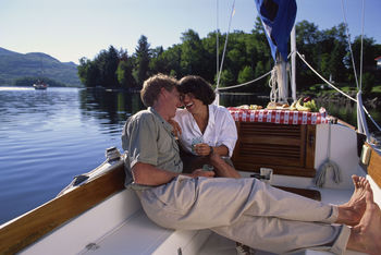 Romantic Couple Relaxing on Sailboat