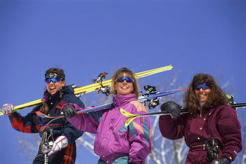 Young Women Skiers Posing on the Slopes