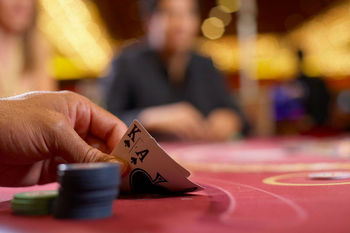 Checking cards in hand of blackjack game