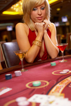 Woman sitting at blackjack table