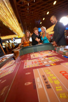 Excited people playing craps in casino
