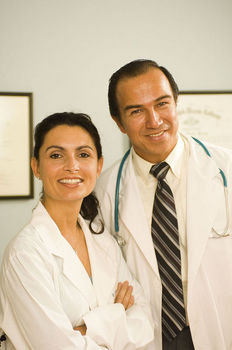 Man and woman doctor posing together