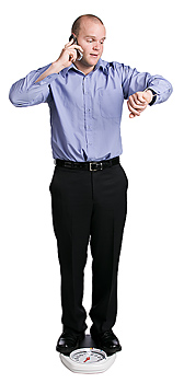 Busy man standing on weight scale