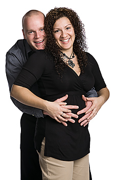 Pregnant couple posing together