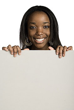 Smiling woman posing with blank board