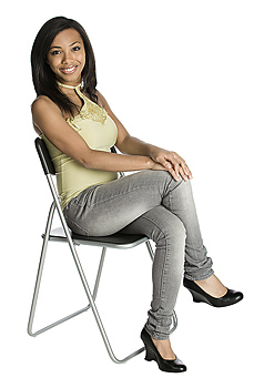 Smiling woman posing in chair
