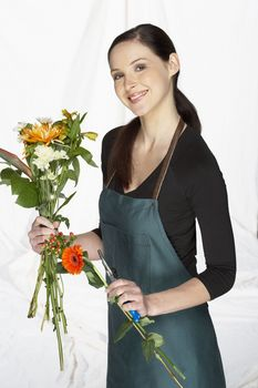 Florist Holding Flowers and Cutters