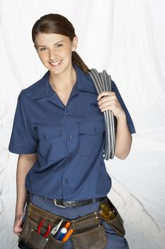 Female Worker with Tool Belt and Hose